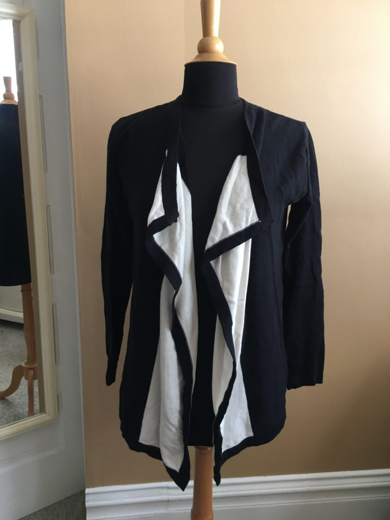store, closet, for sale, clothes, cedar rapids, vintage, fun, dana buchman, sweater, black and white